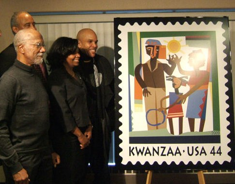 Lloyd McNeil (left) and his Kwanzaa stamp