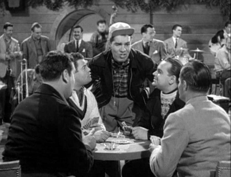 Текс Бенеке (в центре кадра из к/ф «Серенада Солнечной долины», 1941)