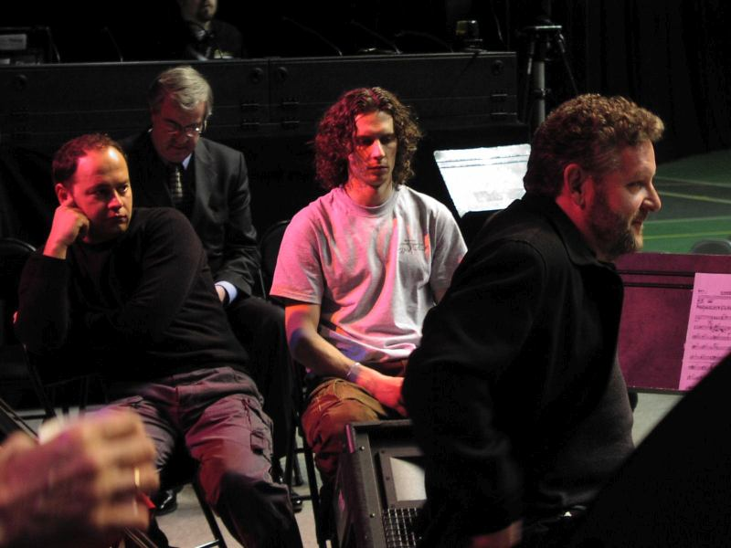 Lionel Hampton Jazz Festival, February, 2005. Doc Skinner and Russian drummers Eduard Zizak and Alex Zinger watch drummer Jeff Hamilton rehearse on the Kibbie Dome Stadium scene during daytime soundcheck (Cyril Moshkow, Jazz.Ru Magazine)