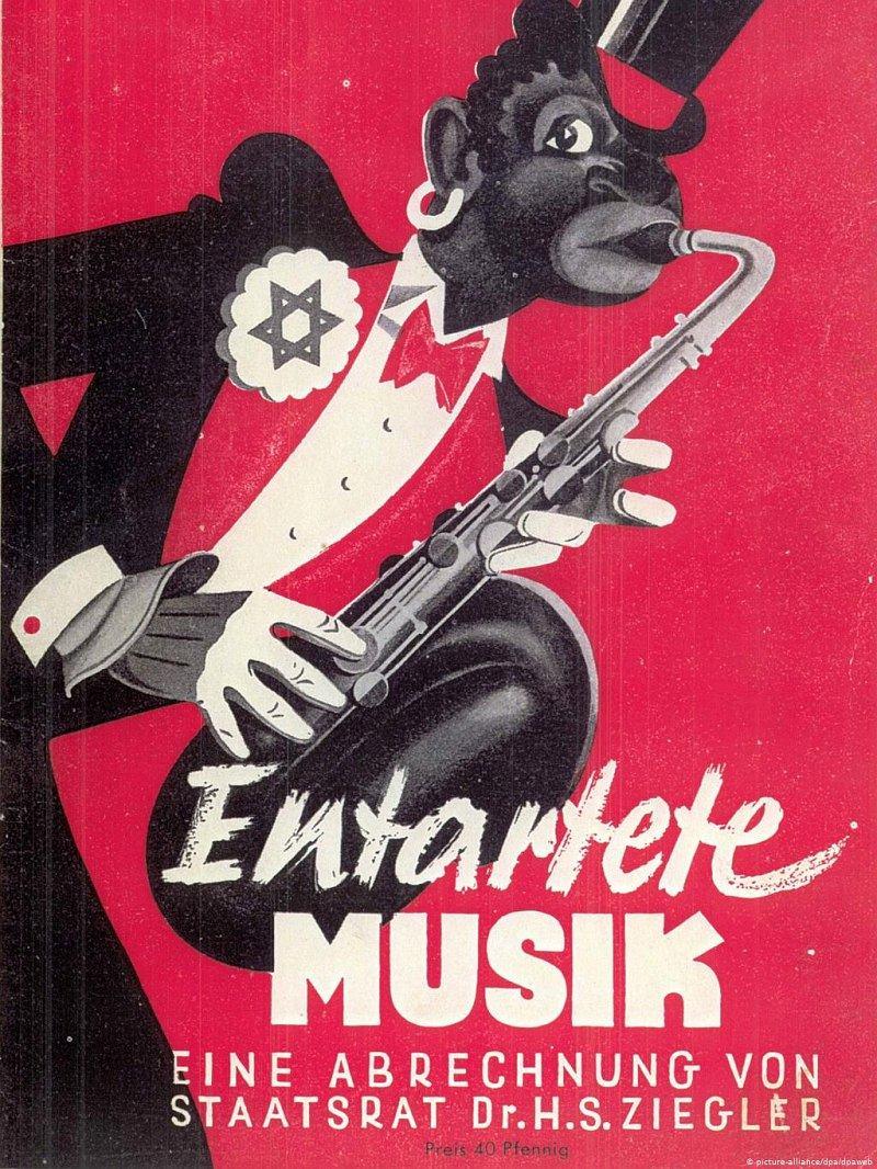 Обложка памфлета «Вырожденное искусство». Нацистский культур-чиновник Ханс Зеверус Циглер написал его к одноимённой выставке в Дюссельдорфе в 1938 г. Всё самое ненавистное нацисту-антисемиту воплощено в обложке, на которой утрированно африканского вида музыкант со звездой Давида на лацкане играет «жидобольшевистскую какофонию» на саксофоне